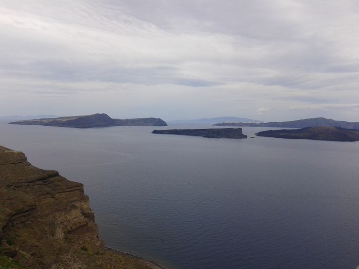 Faros with view to Thirassia island and Oia