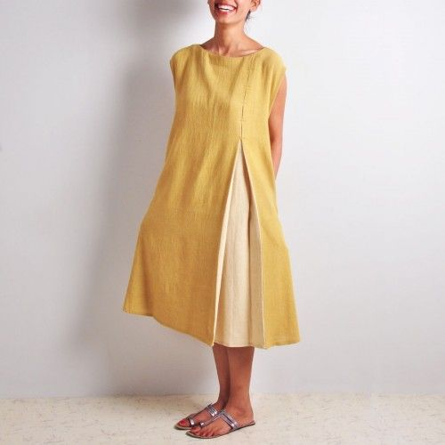 Khadi Tunic  The right mix of cool, sensuous and comfortable features make this tunic a must-have in any wardrobe. The chic loose-fit knee-length tunic has a two-tone effect which instantly catches attention. The asymmetric detail in front packs in the perfect pizzazz. http://www.tadpolestore.com/