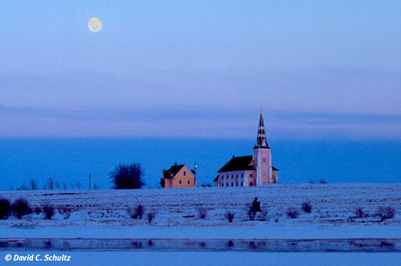 Saint Patrick's church in the winter with full moon on Prince Edward Island, Canada