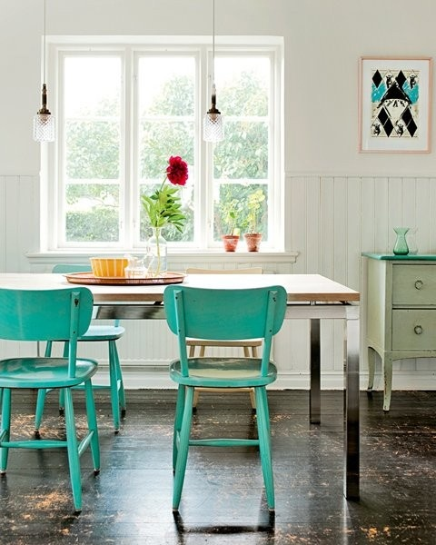 Turquoise painted dining chairs. I've got the blue chairs, I like that table with it.
