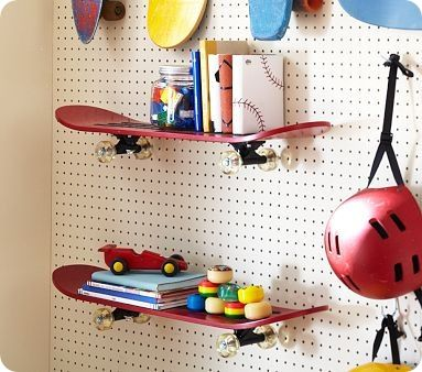 Using skateboards for shelves is such a cute idea for a little boy's room.
