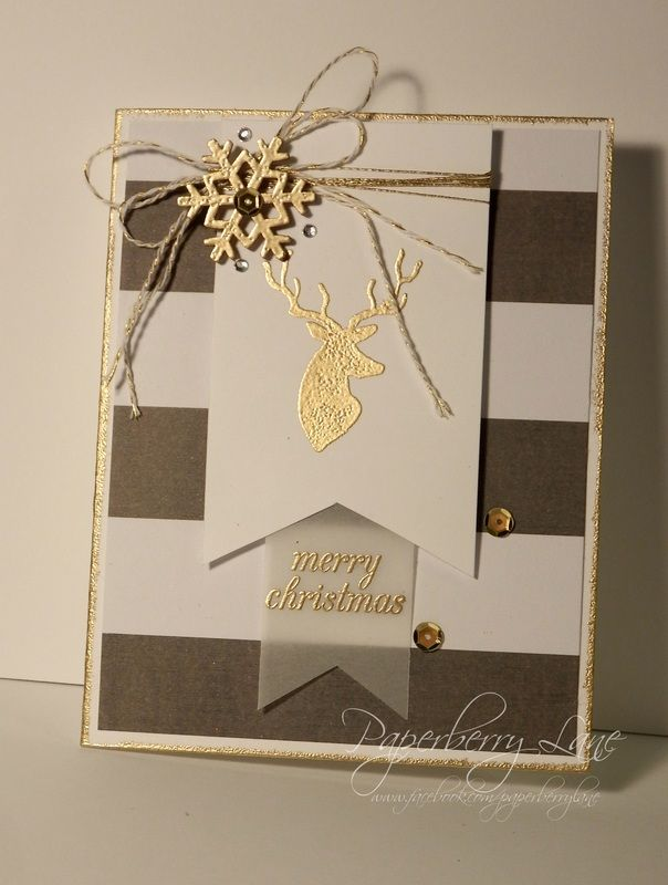 handmade Christmas card ... chocolate, vanilla and gold ... pennant focal point with gold embossed reindear head ... posh styling with gold cord bow topped with sparkly gold snowflake ...