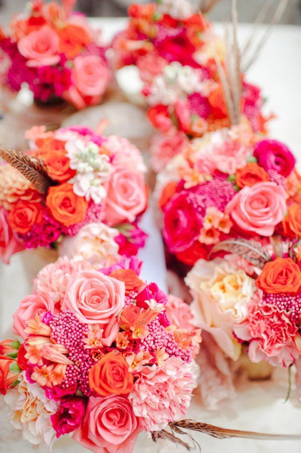 love these colours for the bridesmaid bouquets, but more of a coral than the orange here