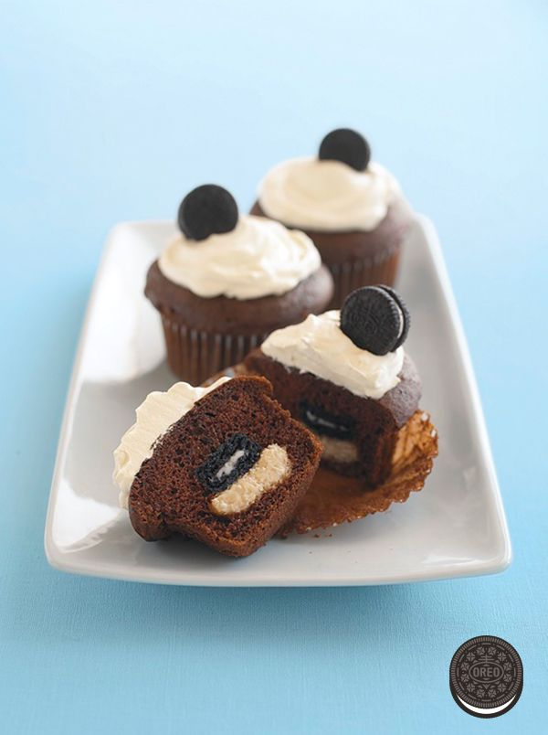 """Who wouldn't love some """"wonderfilled"""" surprises! These sweet, crème-filled Mini OREO Surprise Cupcakes will treat your party guests to big smiles."""