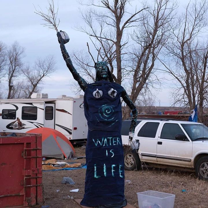 This larger than life size statue was made out of recycled material from the dumpsters of Standing Rock.   -Heather  #standingrock #standingrockreservation #trystanfoundation #mniwiconi #waterprotectors #nodapl #northdakotapipeline #northdakota #protest #environmentalism #environmentalist #waterislife #rezpectourwater #upcycle #upcycled #trash #dumpsterart #trashart #recycle #recycled #art #statue #statuesofinstagram #statues #artiseverywhere #recycledart Trystan Foundation…