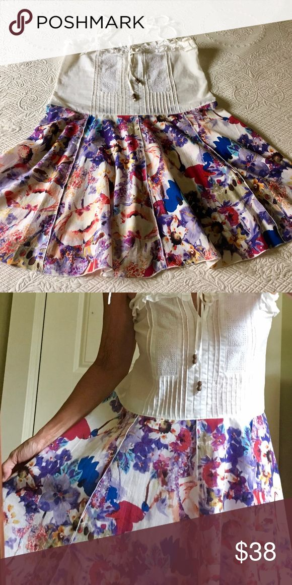 """Upcycled Repurposed Tunic Top Dress XS Repurposed upcycled tunic top dress with a white pin tucked cotton top with tie shoulders paired with a multi colored floral cotton skirt that has flared panels with exposed serged edges. Long enough to be a flirty short summer dress...or to wear with skinny pants. Top should fit XXS-XS...skirt has plenty of hip room.   Bust: 17"""" (across at armpits)  Waist: 18"""" Length: 34""""  All materials are pre-owned, gently used & from thrift stores. Gentle cold water…"""