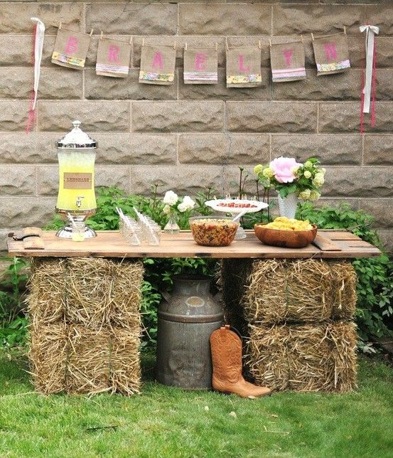 Serve food on hay bales & wooden boards for outdoor cocktail party or child's birthday or for a country themed wedding