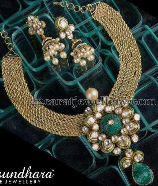 Jewellery Designs: Invisible Emeralds Choker with Jhumkas