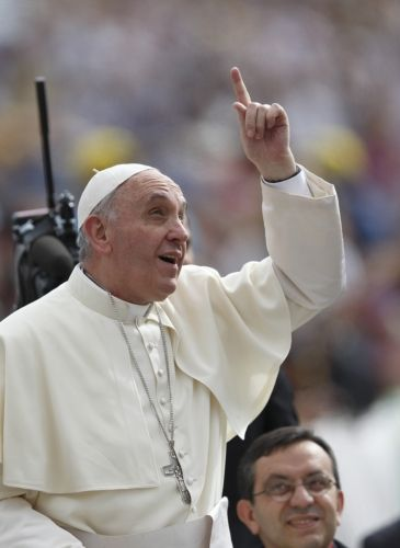 Pope points towards sky as he arrives to lead general audience in St. Peter's Square at Vatican
