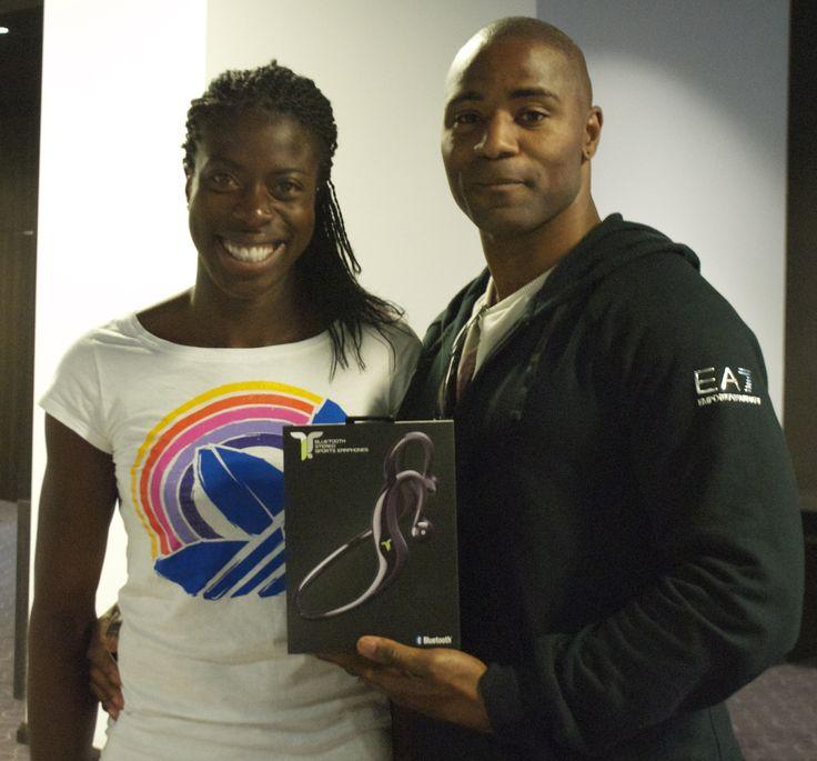 Christine Ohuruogu and Mark Lewis-Francis, British Athletes, Each Having an Olympic Gold Medal, Holding iT7s Sport Headphones