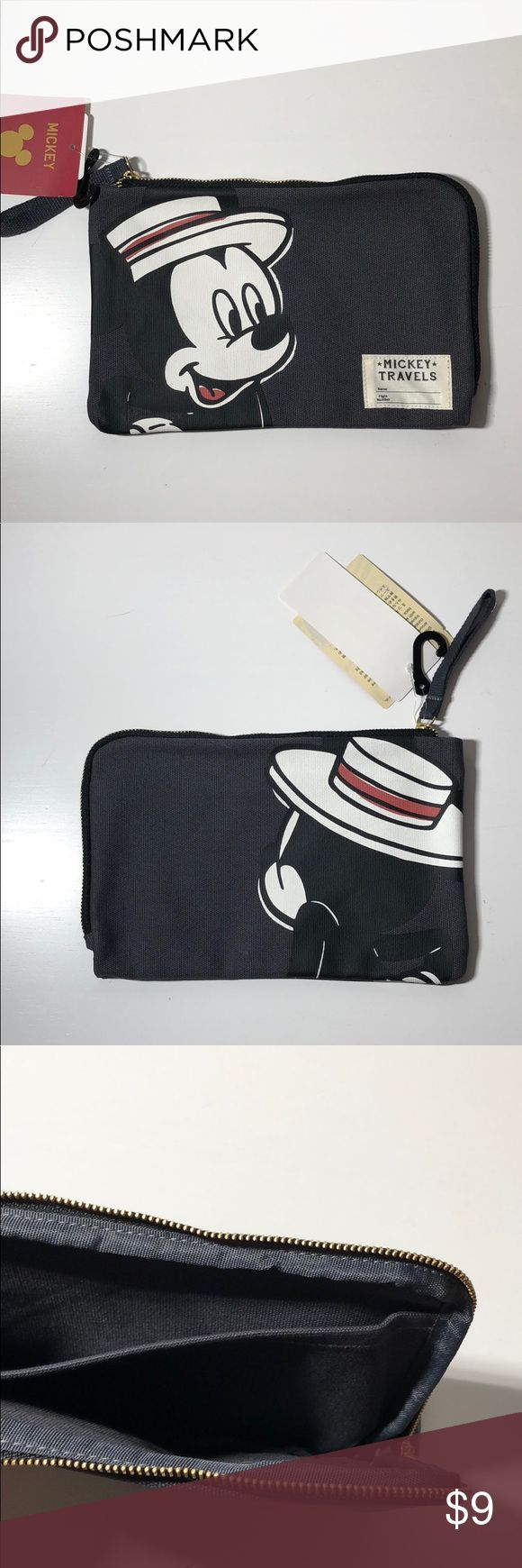 """Mickey """"Mickey Travels"""" bag This Mickey """"Mickey Travels"""" bag was purchased at Uniqlo. It is brand new with tag and super cute! It's about 8.5 inches in length and 5.5 inches in width. It also has an inside pocket. Uniqlo Bags Cosmetic Bags & Cases"""