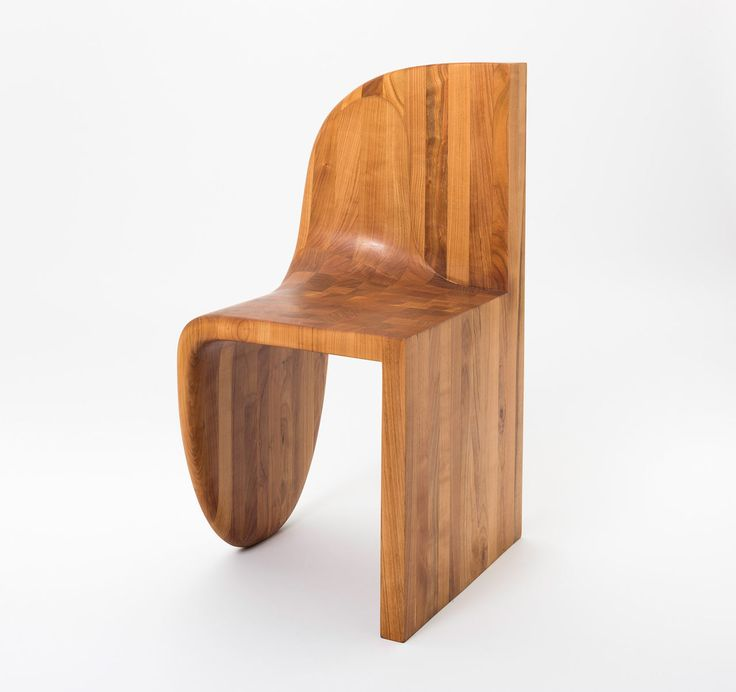Philipp Aduatz combined two different design concepts into one sculptural piece, resulting in a harmonious, modern wooden chair.