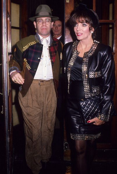 Elton John and Joan Collins during Elton John and Joan Collins at Langan's Brasserie at Langan's Brasserie in London Great Britain