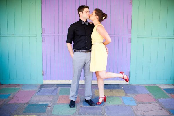 Wedding PR, Wedding Public Relations, WEdding Marketing Expert, whimsical engagement session, colorful engagement session, chalk, bowties, bows, yellow pants, yellow dress, cactus, palm trees, red shoes, polka dots, confetti