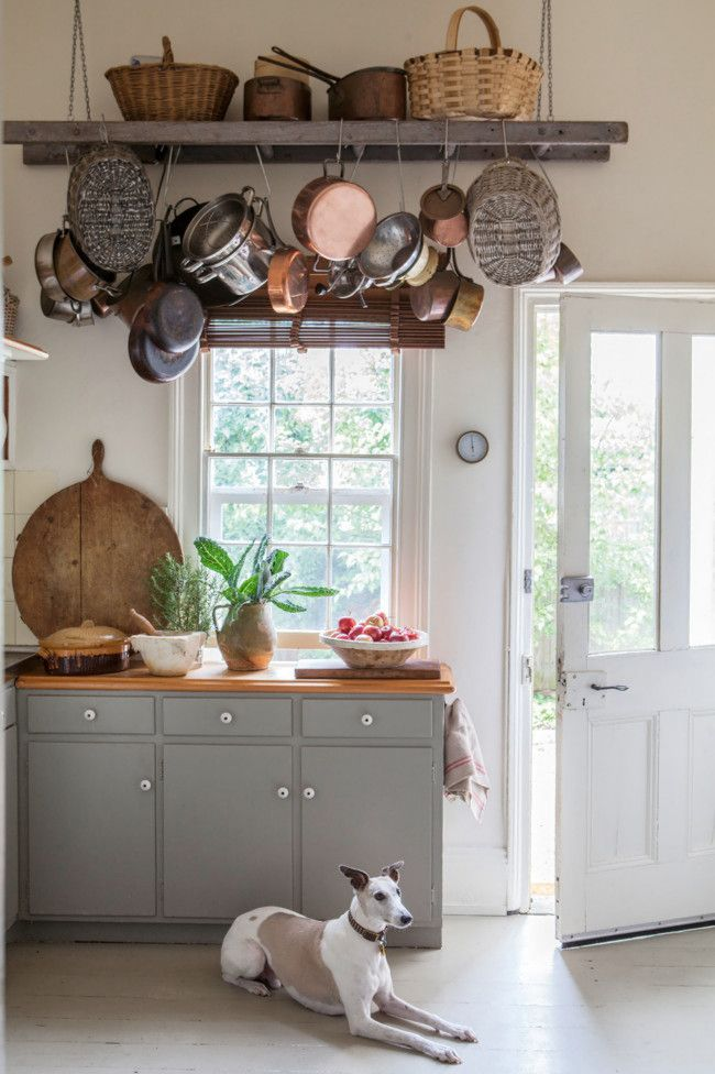 antique ladder pot rack, pale gray cabinets and whitewashed floors