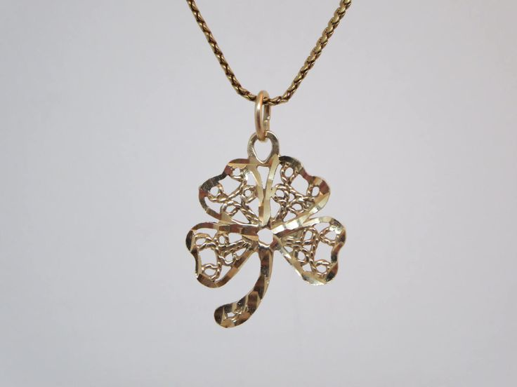 Pretty 10k solid gold four-leaf clover pendant Lucky shamrock symbol The outline of the clover is beveled and the center is filigree style  Stamp: 10k  In good condition Tested and guaranteed!  Size : 2.5 cm x 2 cm: Weight: 2.03 g   **** DISCOUNT CODE! VISIT OUR HOME PAGE **** Https://www.etsy.com/ca/shop/LesCurieux?ref=hdr_shop_menu