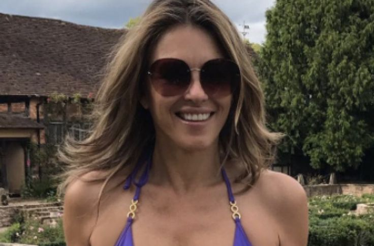 Elizabeth Hurley, 52, flaunts age-defying physique in revealing purple swimsuit