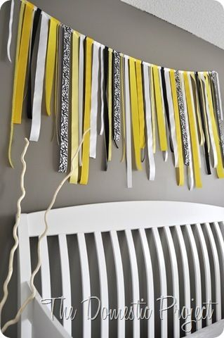 Love the DIY ribbon bunting above the baby bed!!