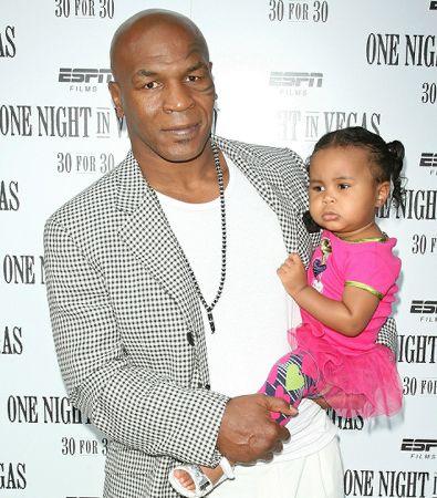 Mike Tyson with daughter Milan. #Kids #Clothes #Celebrities   http://www.devlishangelz.ca/