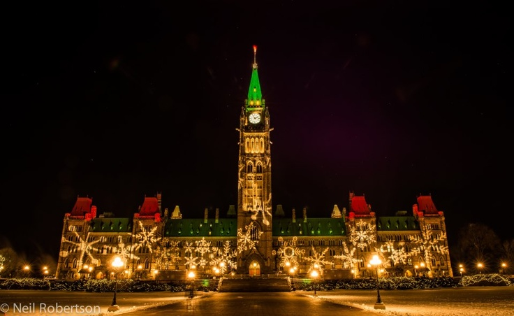 Parliament Hill aglow for Christmas Lights Across Canada in Ottawa.   For more information on Christmas Lights Across Canada visit http://www.ottawatourism.ca/en/visitors/top-attractions/christmas-lights-across-canada