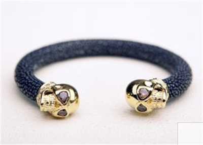 $149.00  http://www.girlswithgems.com.au/category/bracelets/carly-paiker-skull-cuff-black-gold