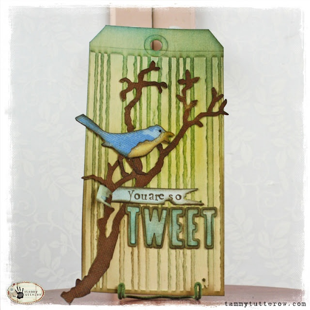Tim Holtz Bird Branch, Inside Out, and Tattered Banner dies and Stripes Texture Fade.  Tag by @Tammy Tutterow.