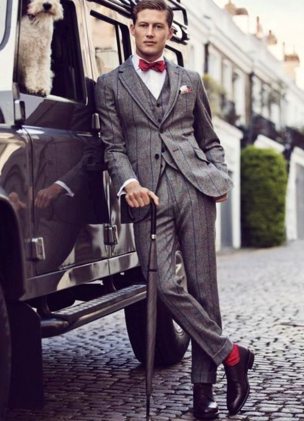 Turn ups, dickie bow, cool grey suit, waistcoat and even a dog in his jeep for good measure. This guy is killing it.