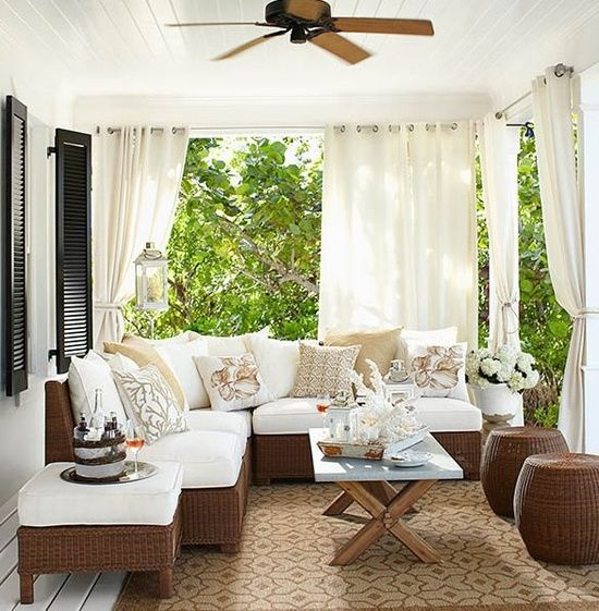 Curtained porches...yes! I think I could spend hours lounging here....day-dreaming, reading, sipping a nice glass of vino...