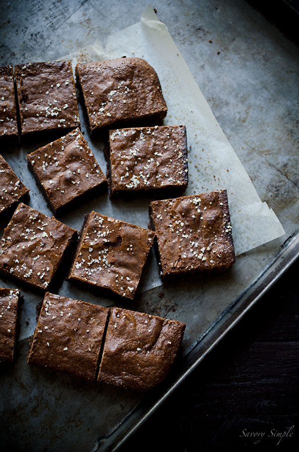 Salted Olive Oil Brownies from Savory Simple are a decadent, sweet and salty chocolate treat. They're some of the best brownies you'll ever taste.
