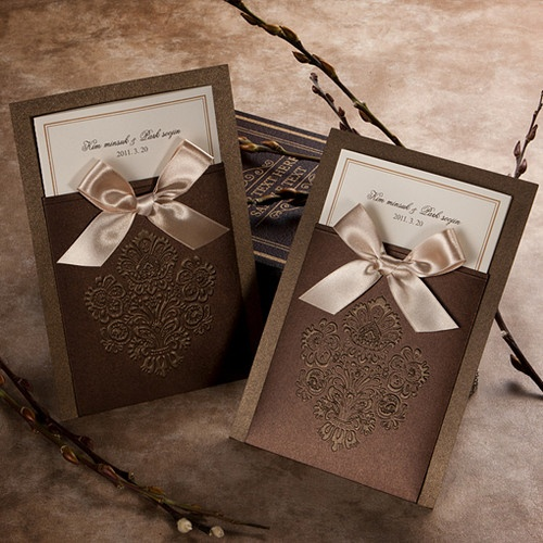 brown wedding invitations. We could get gold cards to insert in the pockets