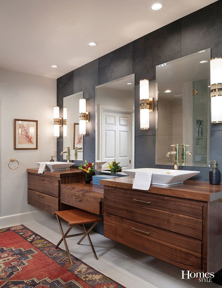 a decided layer of warmth and comfort is written all over this master bathroom the
