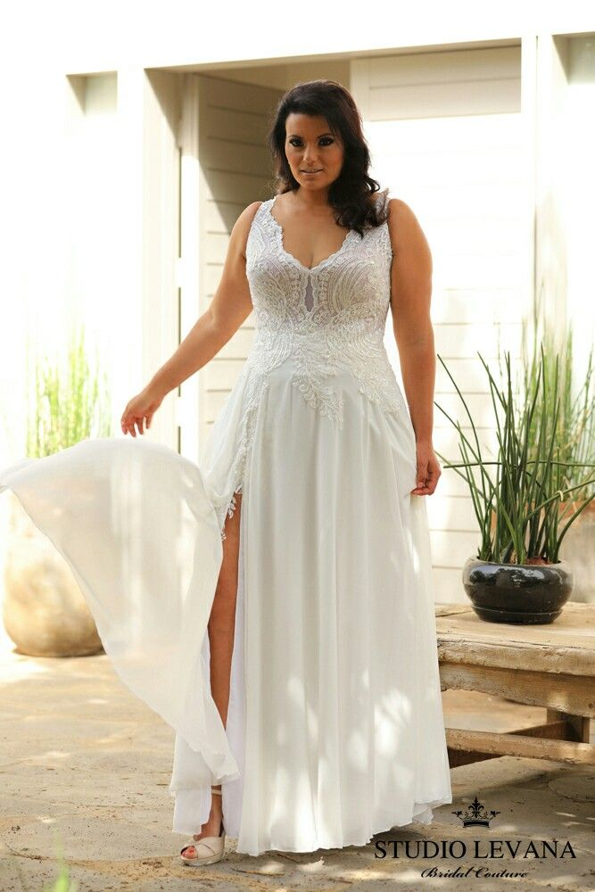 Romantic flowy plus size wedding gown with a sexy slit and for Lace top plus size wedding dress