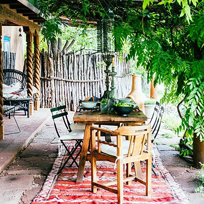 Take a rug outside: This one from Mexico brings color and comfort to a outdoor dining area.