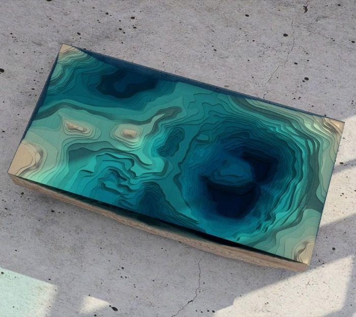 ABYSS: mesa que imita la profundidad del océano. Mesa de centro fabricada a mano en madera y vidrio, para recrear la topografía de un fondo submarino, y el agua. Se fabrica una edición de 25 unidades. Chris Duffy.      #Muebles