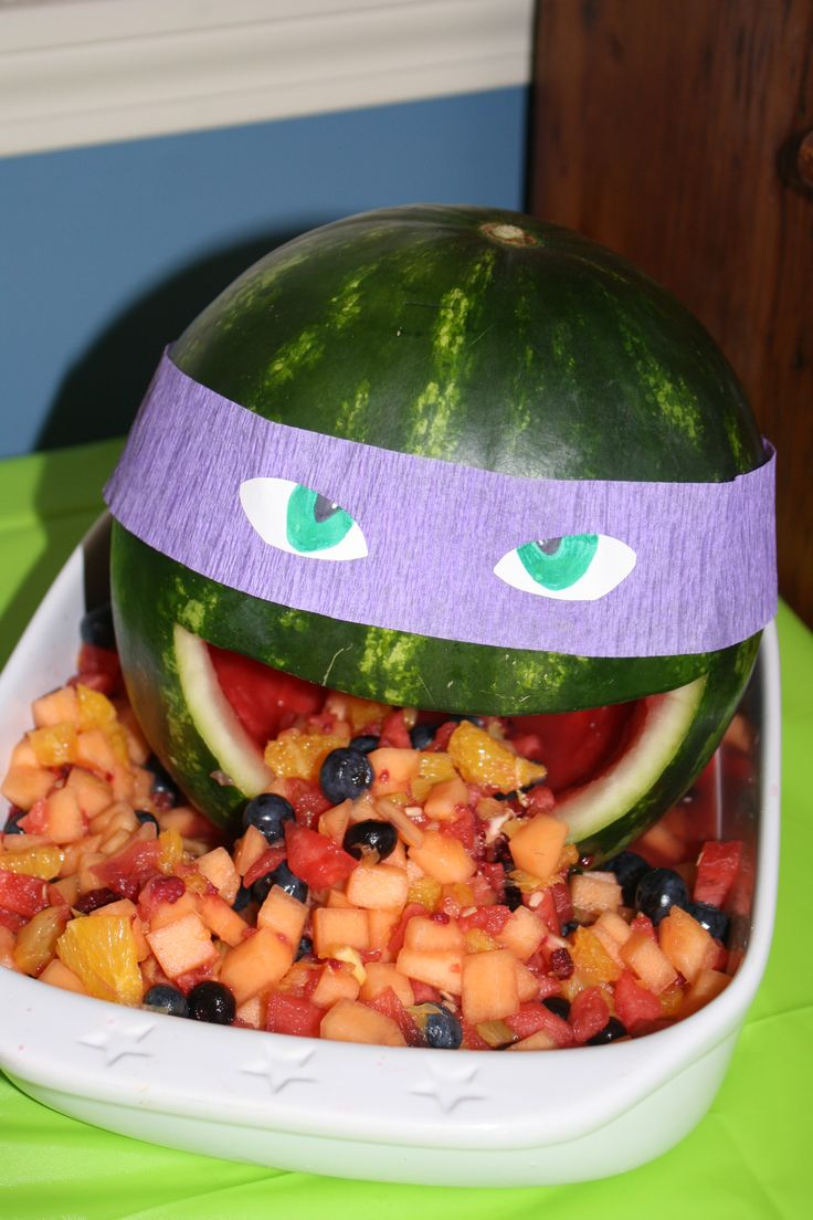 "TMNT ""Donatello"" Fruit Salad Watermelon head with purple streamer mask."