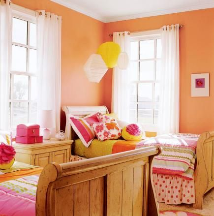 Feel playful        Children respond happily to orange. It's like a goldfish or a clown's carrot-top hair. In this little girl's bedroom, the orange walls (Kwal 7354D Orange Buff) paired with pink and turquoise accents create a playful mood and add the right amount of energy