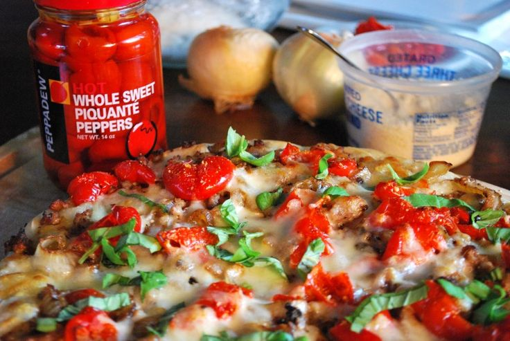 I just want to say Peppadew® Pepper Pizza all day long. (Try it!) We picked a peck of them for this recipe, that's for sure. (Actually, they come in a jar—there was no picking involved.) This pizza has all of my favorite bites: sweet sausage, caramelized onions (which, by the way, I would eat on ice cream if the world would let me) fresh basil, ooey-gooey mozzarella and, of course, the star of the show: Peppadew® Whole Sweet Piquante Peppers. #sponsored