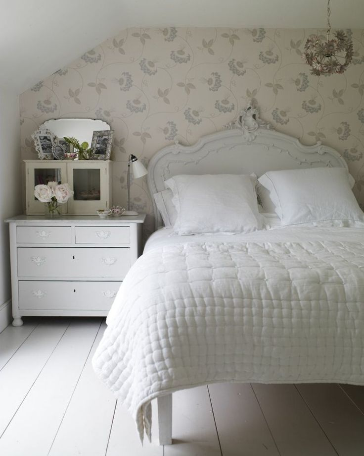 diagonal stencil accent wall in bedroom