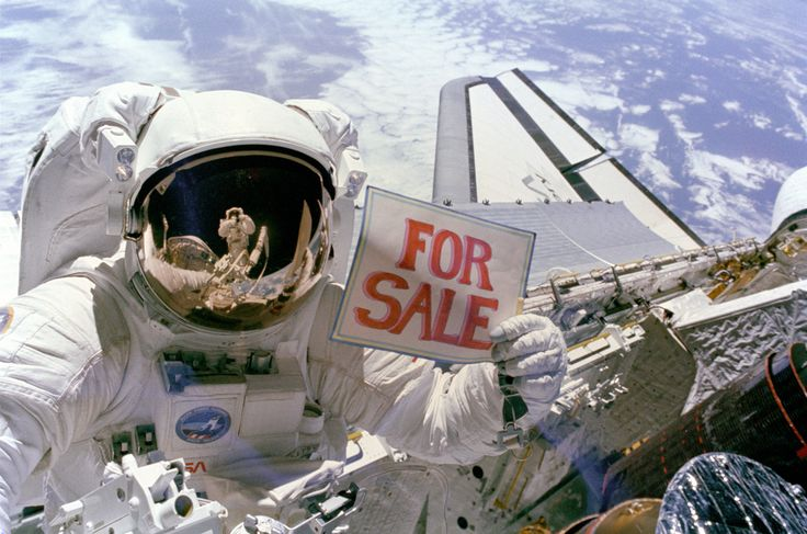 astronaut holding a for sale sign...my type of product!  Selling Real Estate Anywhere!