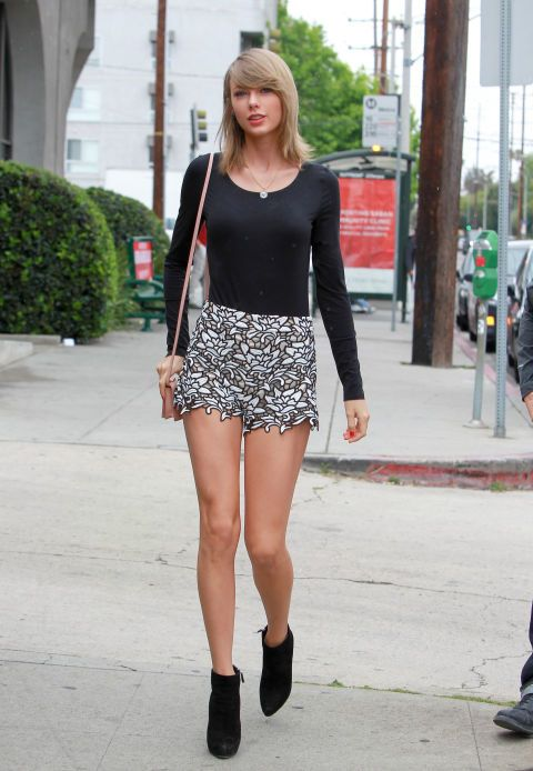Out in Los Angeles in Alice + Olivia shorts, Prada shoes, a Charlotte Olympia bag, and an Irene Neuwirth necklace. See all of Taylor Swift's best looks.