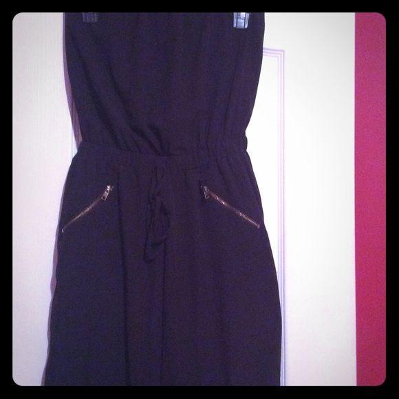 Black strapless jumpsuit Beautiful black jumpsuit. Strapless. Gold zippers on pockets. Elastic waist As u wish Pants Jumpsuits & Rompers