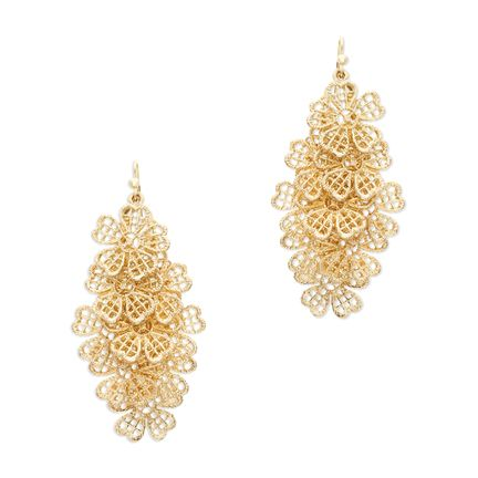 The delightfully delicate Daisy drop earrings are an eye-catching staple. These cascading filigree beauties are the perfect neutral day-to-night accent, shown off best with an up-do!