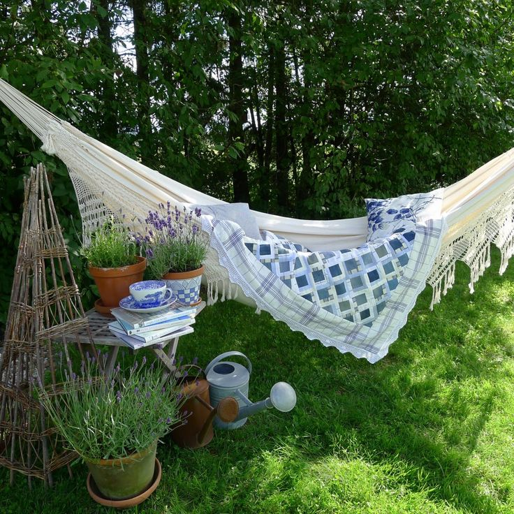 A lovely, tranquil, shady spot to read a book or page through a magazine, swaying  in the breeze to nap . . .I'm already there.