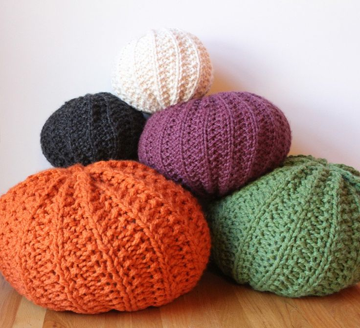 Hand knit poufs - like bean bags.  They look so comfy!  Perfect for a playroom or a child's room.