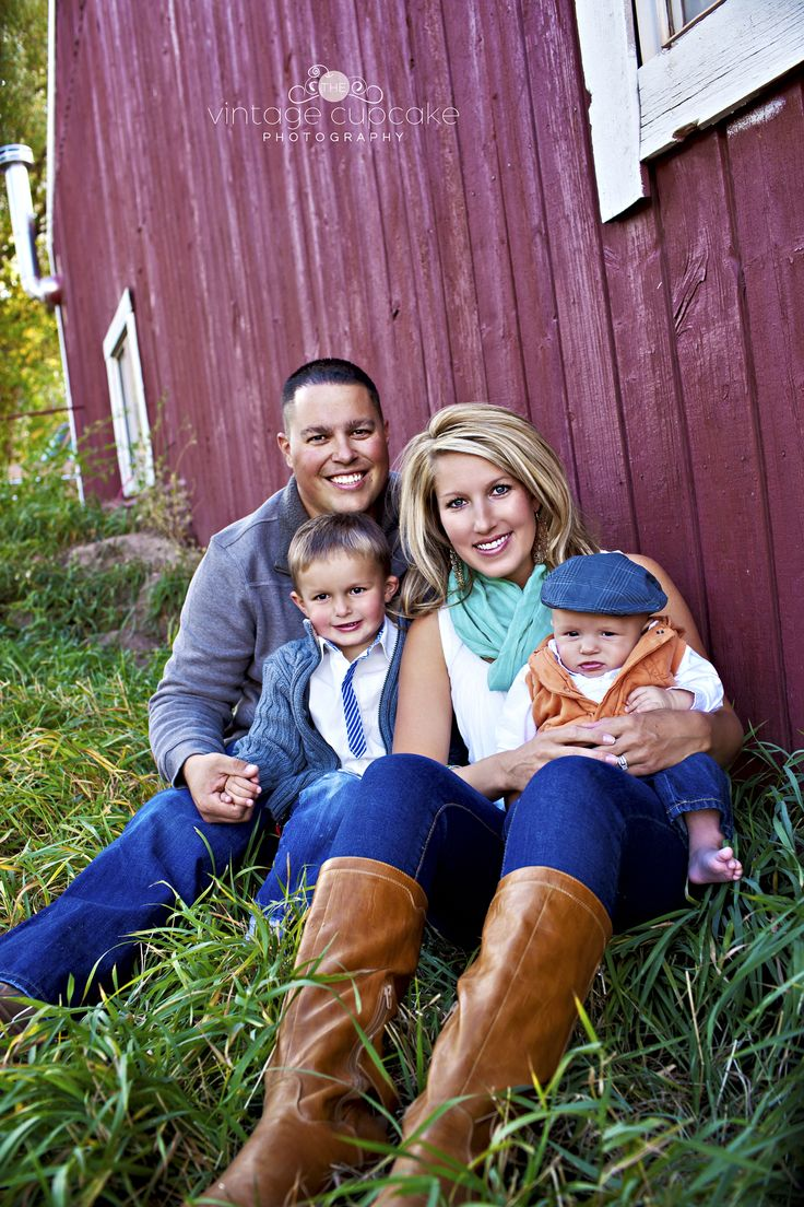 Adorable Family Sitting Infront Of Old Red Barn For Fall PortraitsDenver Colorado And