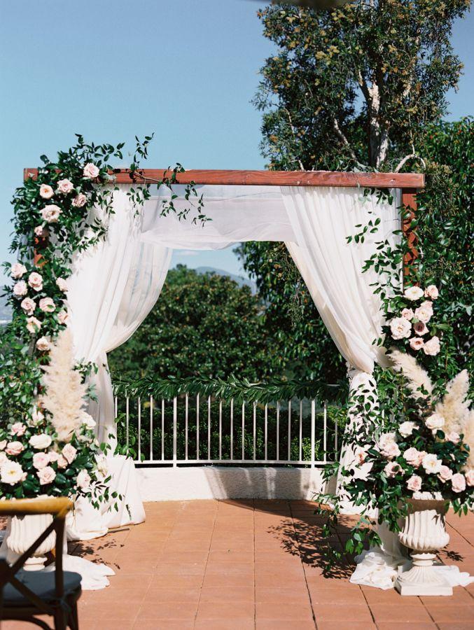 Romantic Laguna Hills wedding ceremony: http://www.stylemepretty.com/california-weddings/laguna-hills-california/2016/03/17/romantic-flower-filled-laguna-hills-wedding/ | Photography: Carmen Santorelli - http://carmensantorellistudio.com/