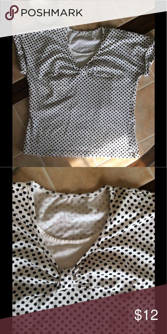 Black and White Pokie Dot Top Black and White Pokie-Dot Top, No Tags, Fits like a medium or large. It's Cotton with Spandex: Tops Tees - Short Sleeve