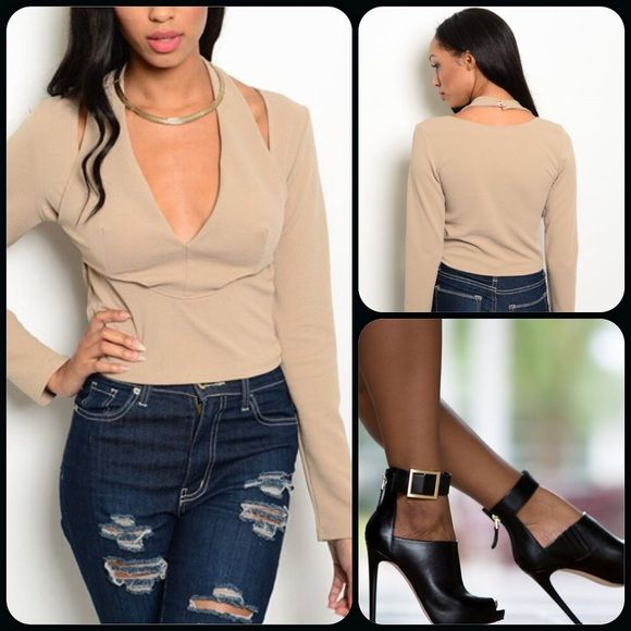 Beige Trendy Top This chic top features long sleeves with a halter style neck closure with buttons. Comfy knit. 95% Polyester, 5% Spandex. (This closet does not trade or use PayPal.) Manito Tops
