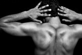 Back of muscular athletic young man over black stock photography