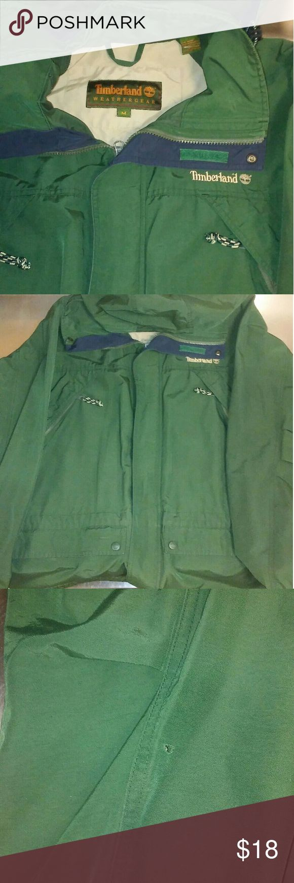 Timberland Weathergear Medium Jacket w Hood This is in great shape. It is medium sized. Weathergear branch of Timberland. Hood is retractable. Has a very small hole shown in picture 3 on the sleeve. Very small. And a spot on the bottom of the back of it. Still inside is in great shape. Timberland Jackets & Coats Raincoats